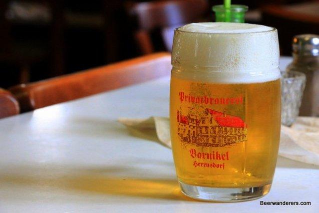 yellow beer in mug with big head