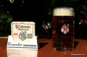 amber beer in mug with coaster