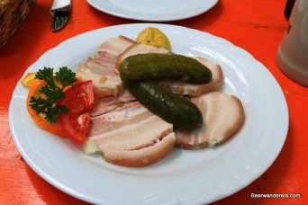 meat on plate with pickle