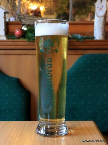 light yellow beer in tall glass