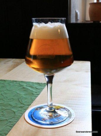 deep golden beer in wine glass