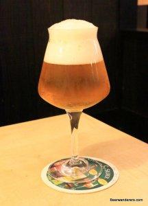 unfiltered golden beer in wine galss