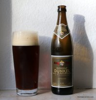 dark beer in glass with bottle
