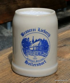 beer in ceramic mug with logo