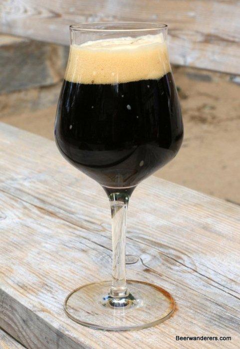 black beer in wine glass