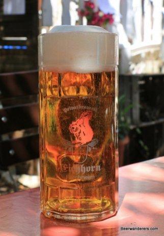 golden beer in mugwith big head