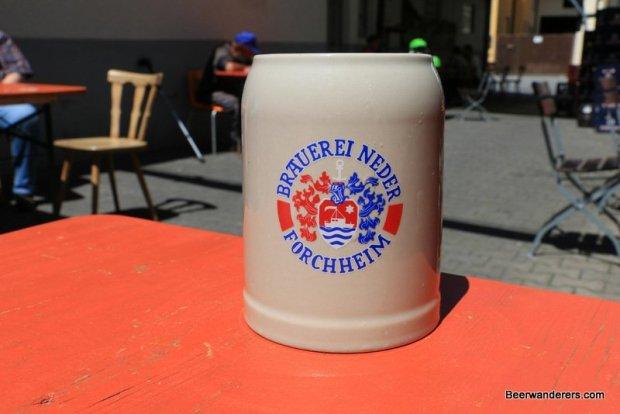 beer in ceramic mug with logo