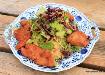 breaded chicken cutlets over salad