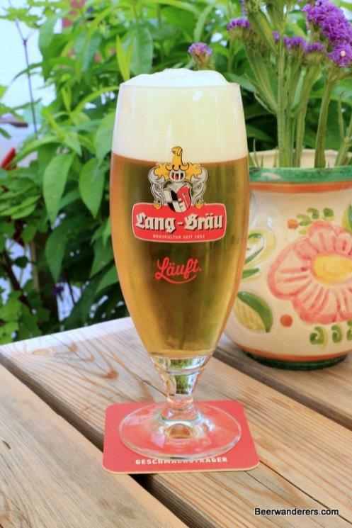 yellow beer in pils glass
