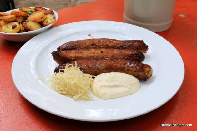 tasty Bratwurst with horseradish and Bratkartoffeln