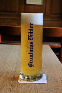 unfiltered yellow beer in mug