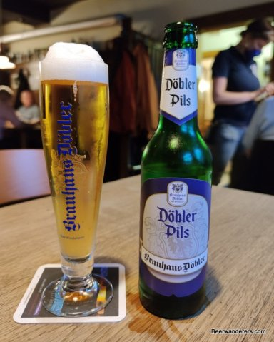pils in glass with bottle