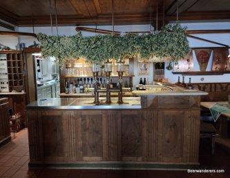 bar strewn with hops