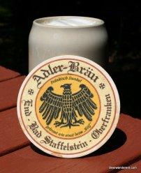 beer in ceramic mug with coaster