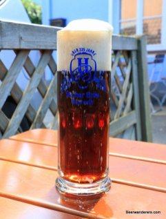 dark beer in mug with big head
