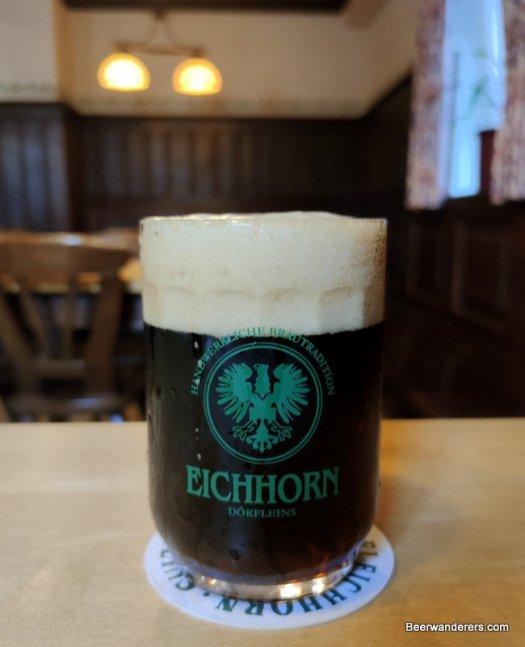 darm beer in mug with huge head
