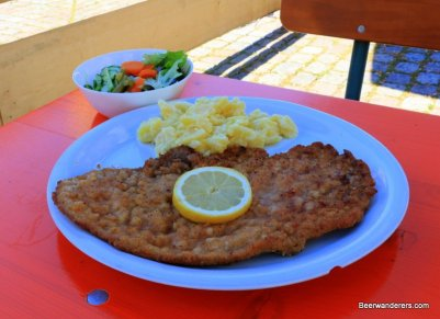 huge schnitzel with potato salad