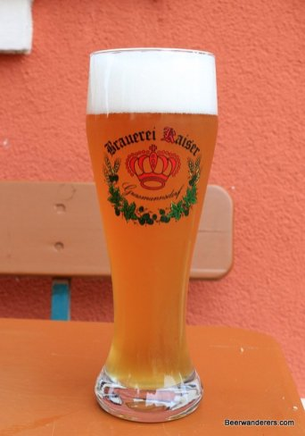 weissbier in glass with logo