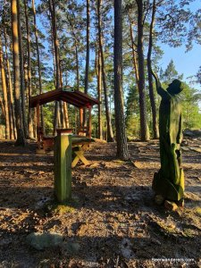 wooden statue with picnic table
