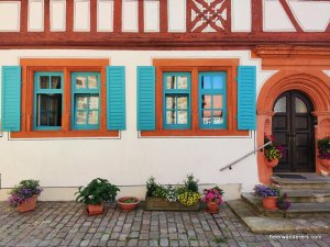 house with colorful window shutters