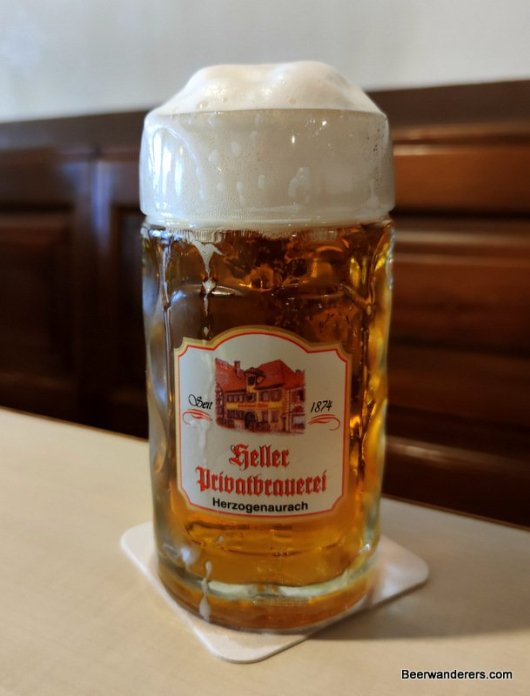 golden beer with big head in logo mug