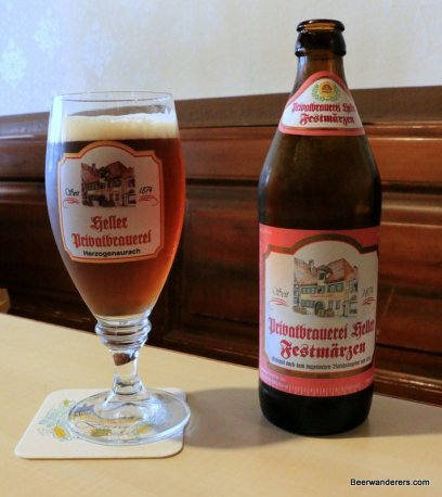 amber beer in glass with logo and bottle