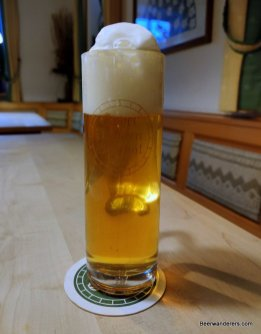 unfiltered golde beer in mug with large head