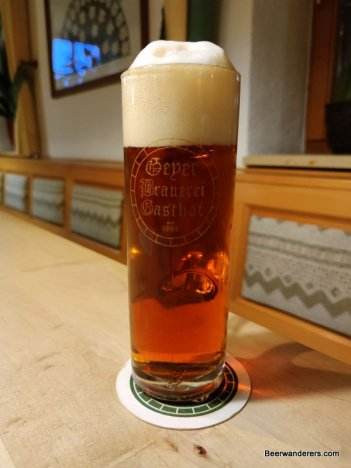 amber beer in mug with logo
