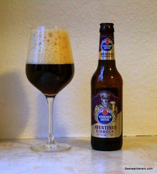 dark beer in wine glass with bottle