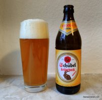 unfiltered beer in glass with bottle