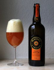 amber beer in wine glass with bottle