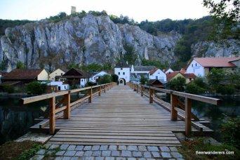 wooden bridge with cliffs