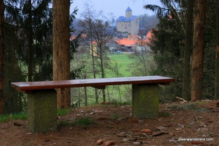 bench on hike with view of castle