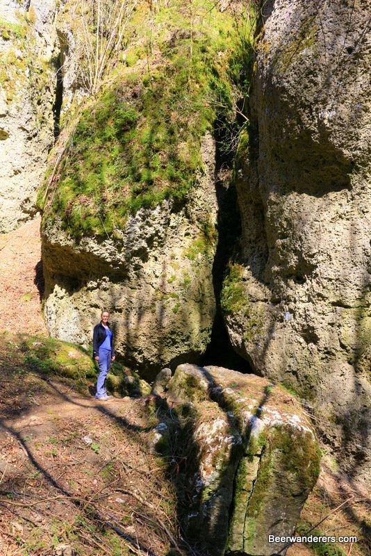 woman hiker entering cave