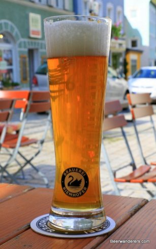 beer in tall thin glass with schwan logo