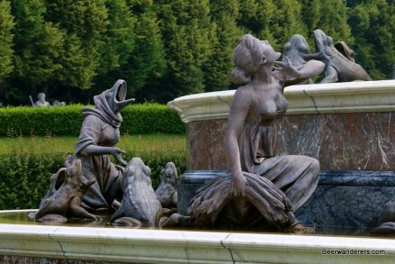 frog and maiden statues in fountain