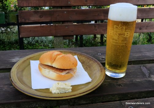 smoked fish sandwich with beer