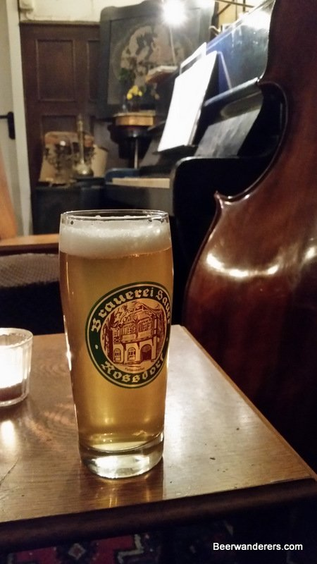 beer in log glass with piano
