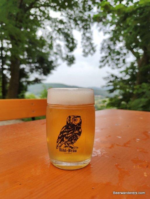 unfiltered golden beer in logo mug
