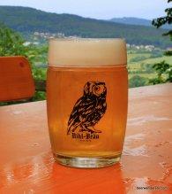 unfiltered golde beer in mug with owl logo