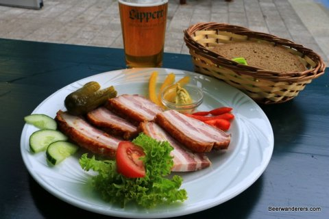 cold cots on plate with pickel and bread