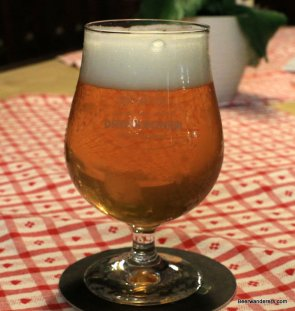 unfiltered golden beer in tullip glass