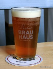 amber beer in glass with logo