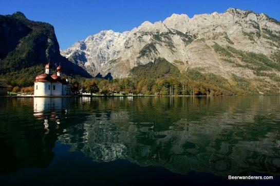 mountain lake with church