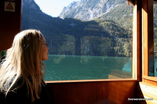 pretty blond on boat in mountains