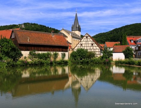 half-timbered house with church steeple in reflections