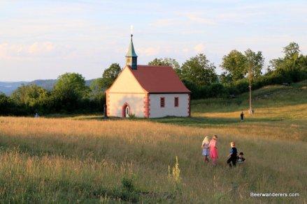 children in front of church