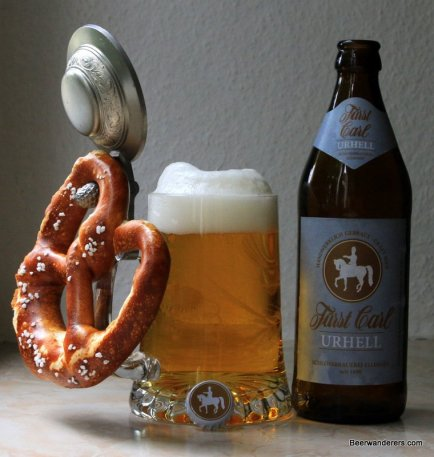 beer in mug with pewter lid and pretzel with bottle