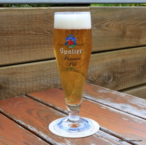 yellow beer in log pils glass