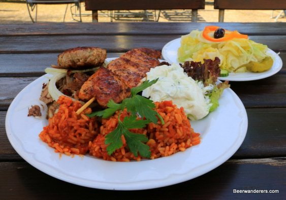 large plate of greek food with rice